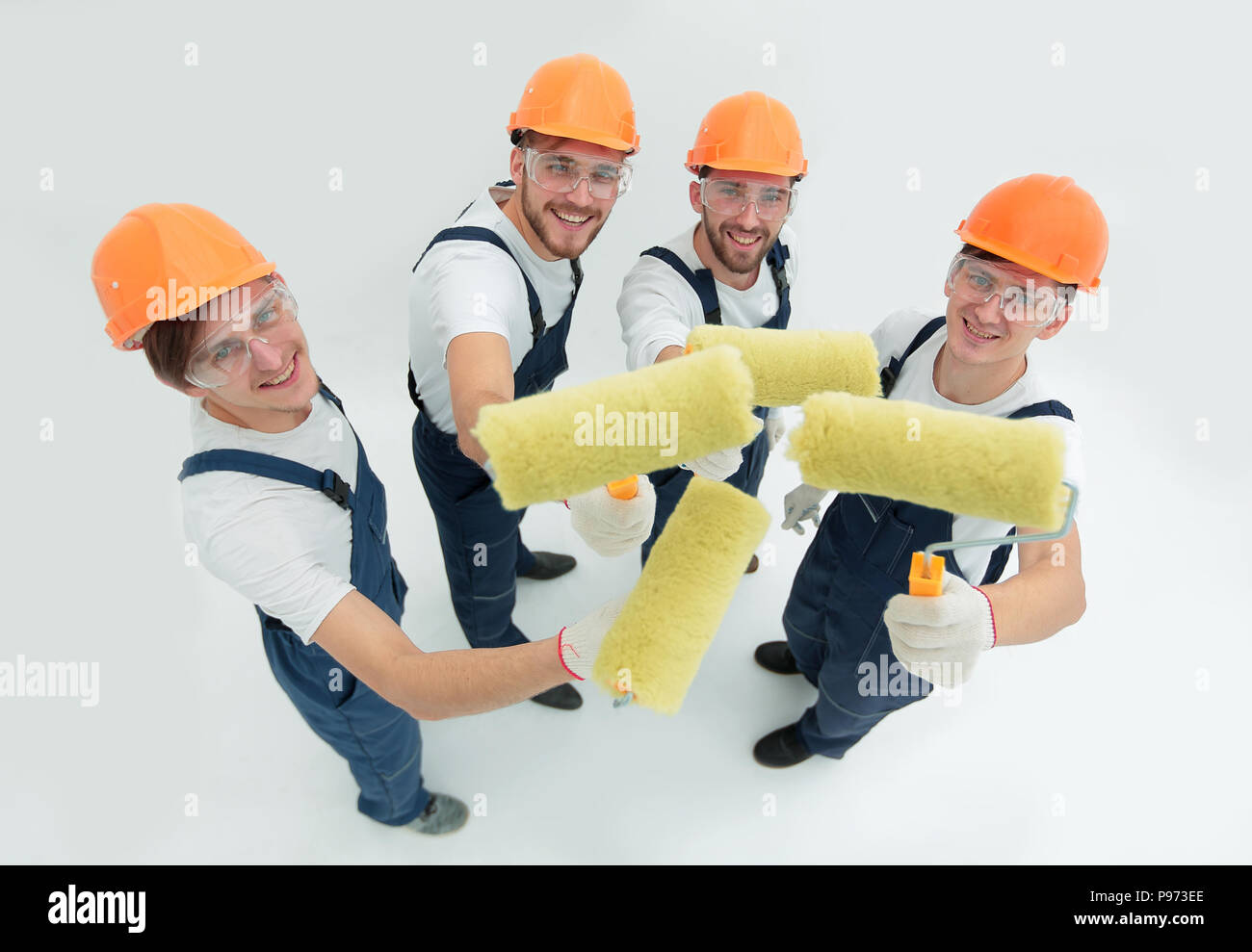 view from the top.a group of decorators with a paint roller - Stock Image