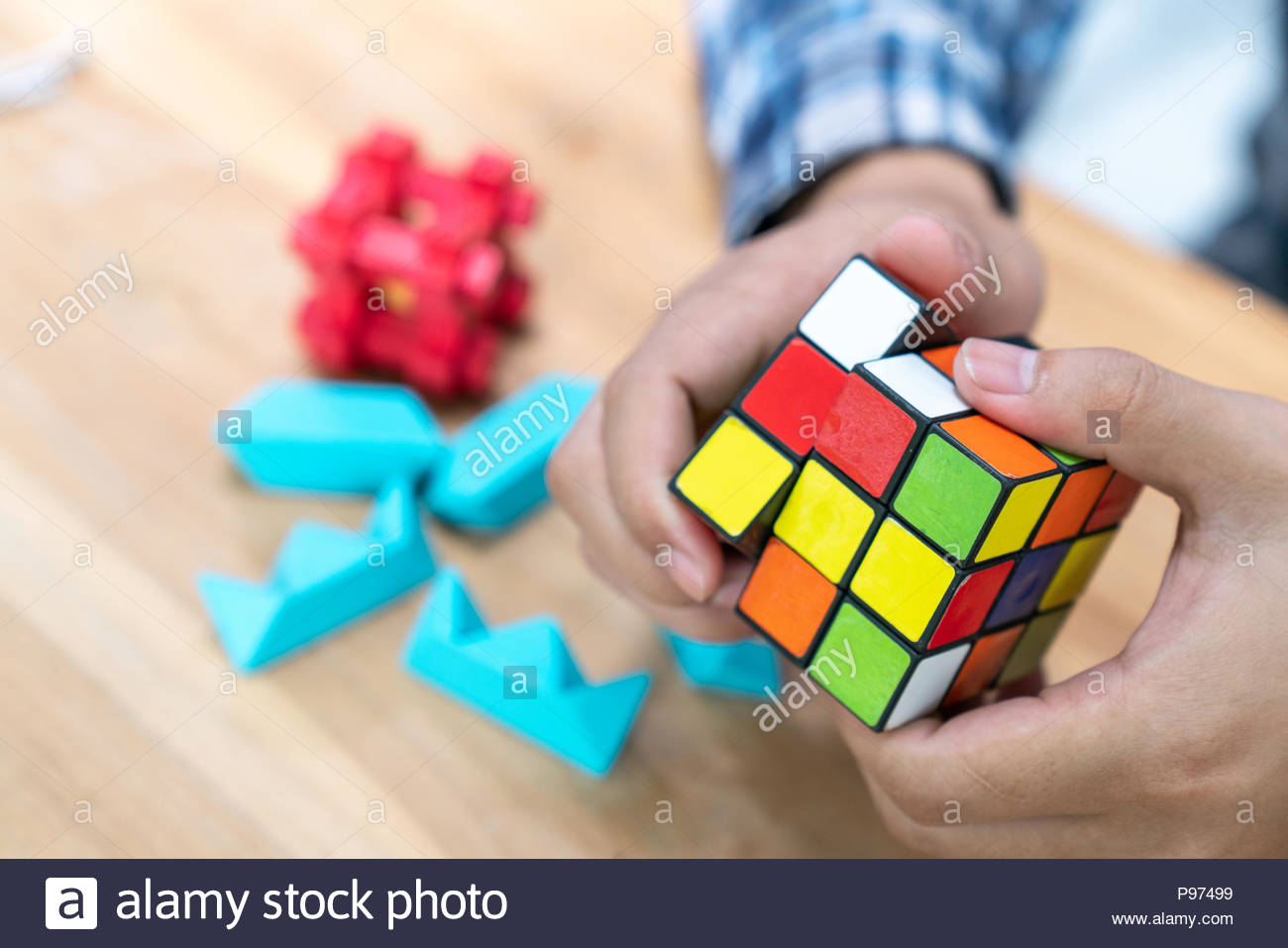 BANGKOK, THAILAND - April 6, 2018: Rubik's cube puzzle In the hands of men. Cube was invented by a Hungarian architect Erno Rubik in 1974. - Stock Image