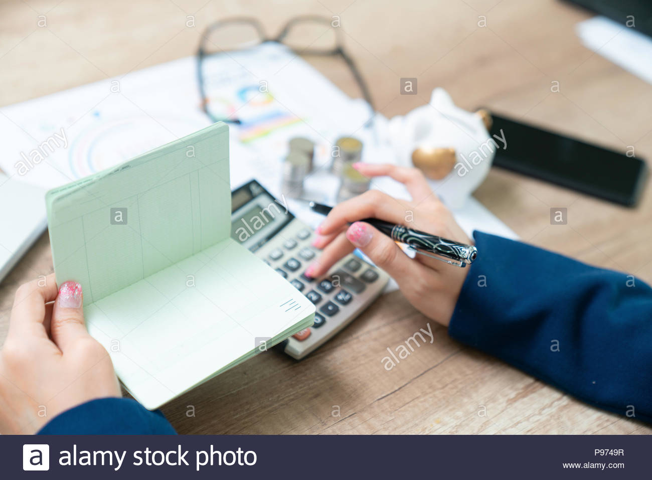 hands holding saving account passbook, - Stock Image