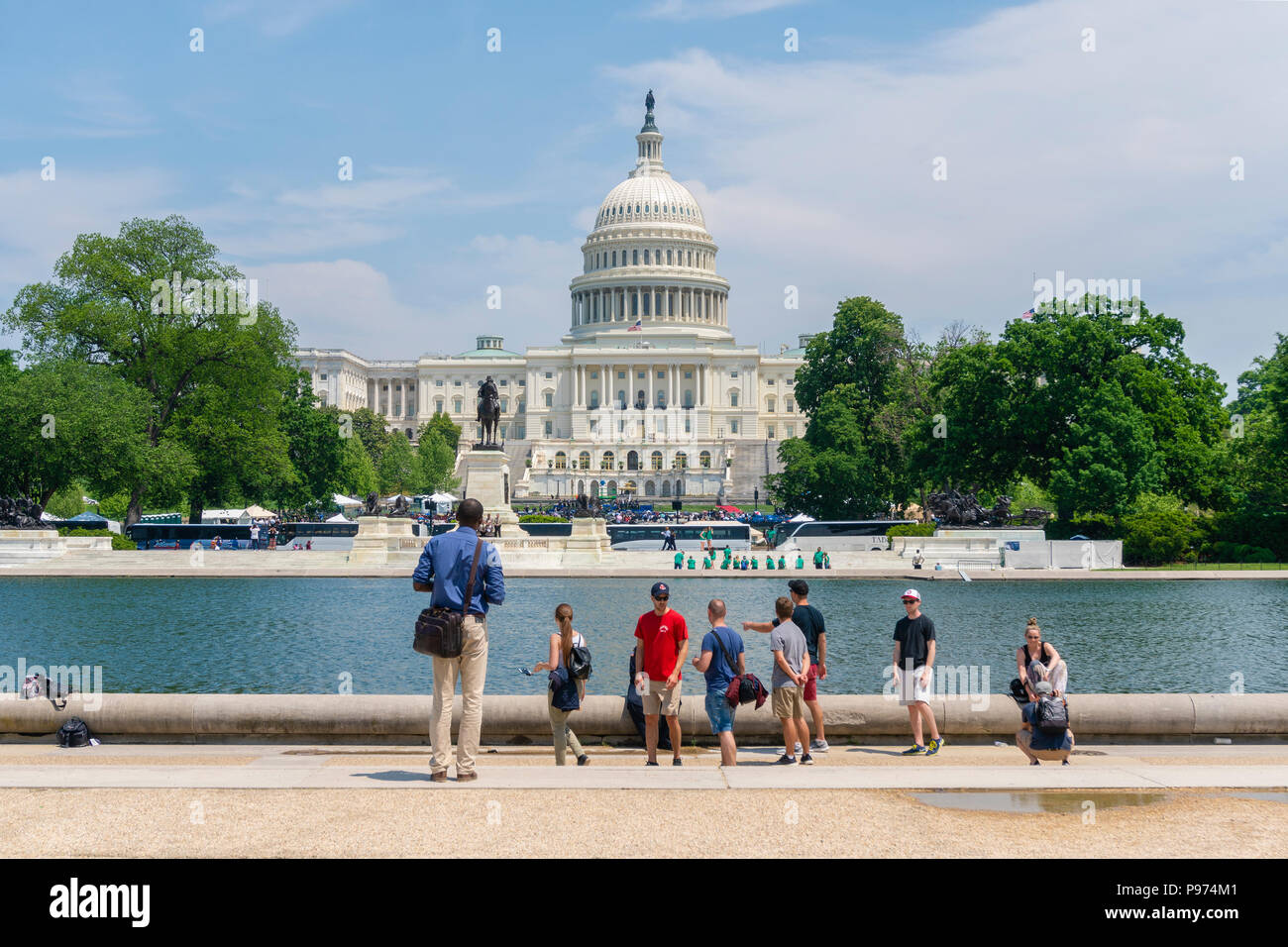 Tourists visiting the United States Capitol. It is the home of the United States Congress - Stock Image