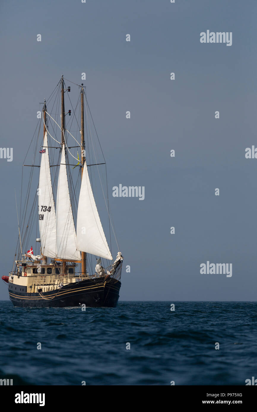 Sunderland, UK. 14th July 2018. The Skonnerten Jylland, a Danish ship, on the North Sea at the beginning of the first leg of the 2018 Tall Ships Race, to Ebsjerg in Denmark. More than 50 tall ships were docked in the Port of Sunderland, in north-east England, from 11 to 14 July 2018. Credit: Stuart Forster/Alamy Live News - Stock Image