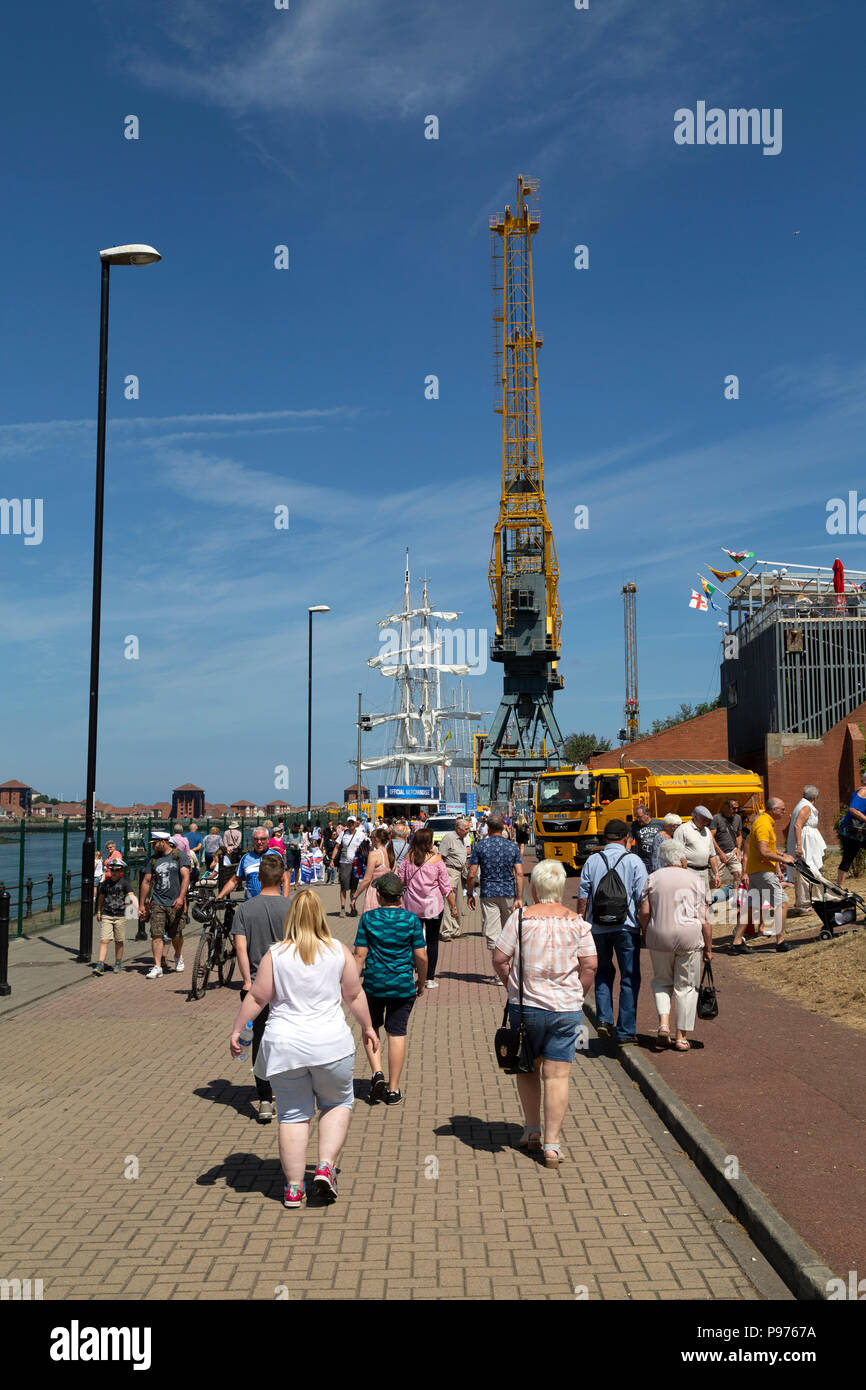 Sunderland, UK. 14th July 2018. People head to the Port of Sunderland for the Parade of Sail marking the start of the 2018 Tall Ships Race  in Sunderland, England. The port hosted more than 50 ships from 11 to 14 July. Credit: Stuart Forster/Alamy Live News - Stock Image