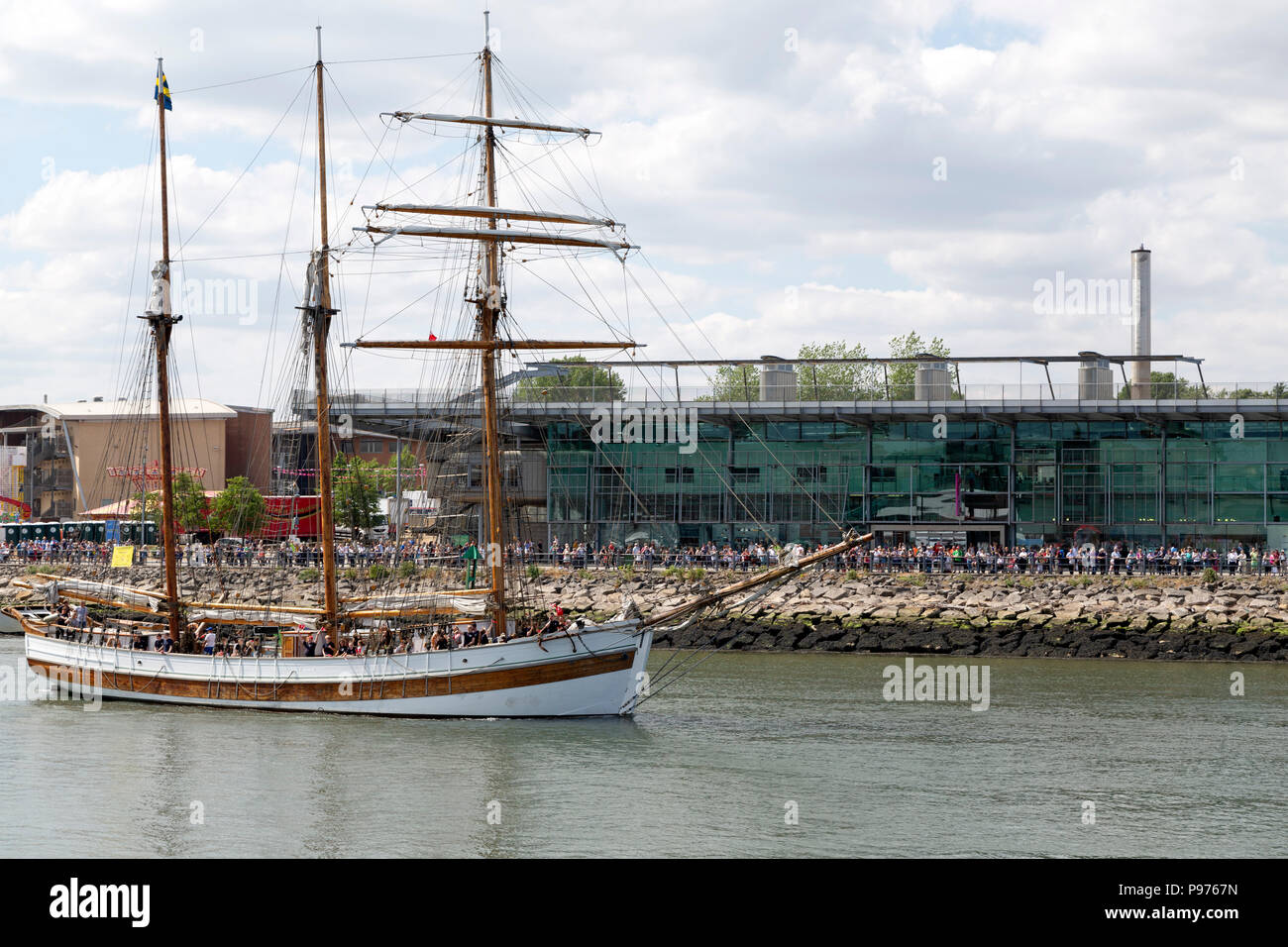 Sunderland, UK. 14th July 2018. The Vega Gamleby sails past the UK's National Glass Centre in Sunderland, England. The ship iis participating in the Parade of Sail at the start of the 2018 Tall Ships Race. Credit: Stuart Forster/Alamy Live News - Stock Image