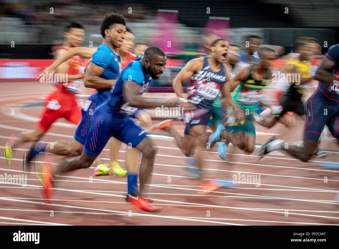 London, UK. 14th July 2018. Male sprinters conduct a baton change in the 4x100m at the Athletics World Cup  at the London Stadium, London, Great Britiain, on 14 July 2018. Credit: Andrew Peat/Alamy Live News - Stock Image