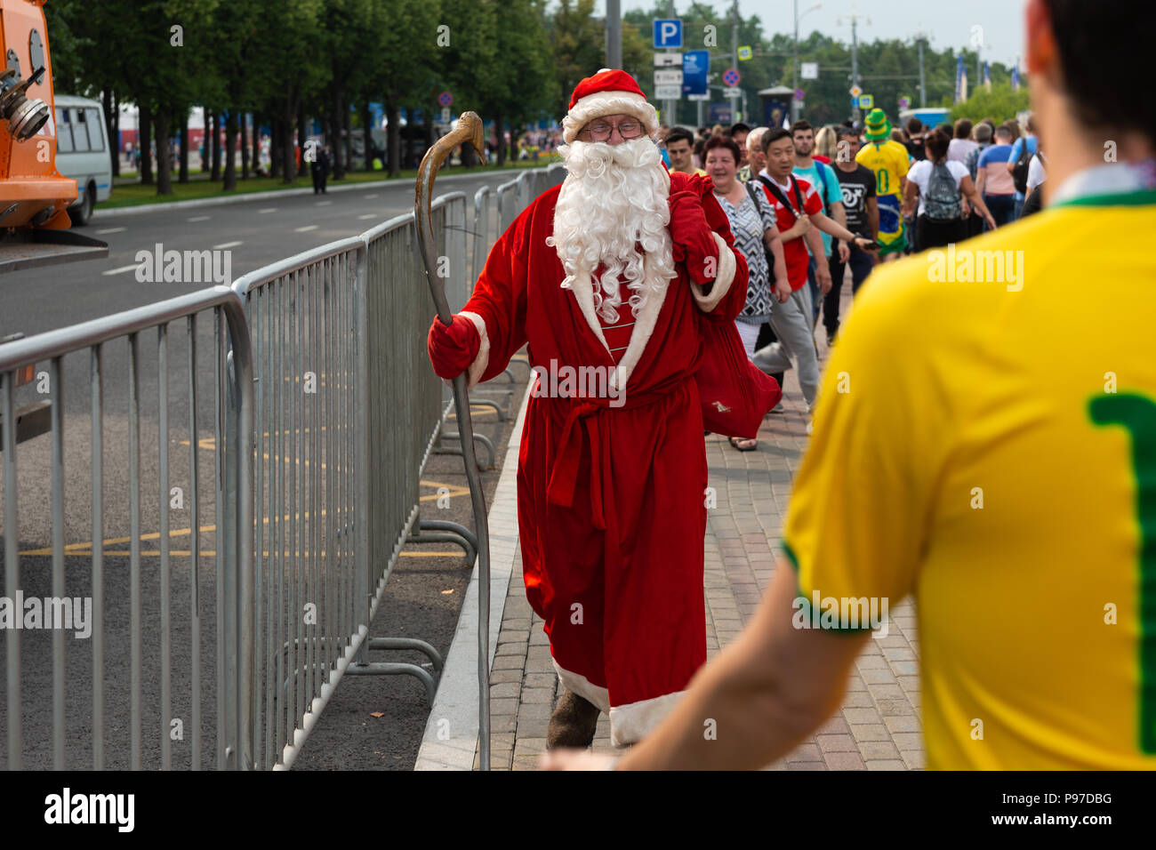 Moscow, Russia. 15th July, 2018. FIFA World Cup France-Croatia final. Fan festival area on Sparrow Hills by the Moscow State University. Area's capacity of 25000 people was exceeded manifold. There is barely room to move. Thunderstorm weather. Unexpected meeting. Santa Clause in the middle of the summer season. Is this the climate change effect? Credit: Alex's Pictures/Alamy Live News Stock Photo