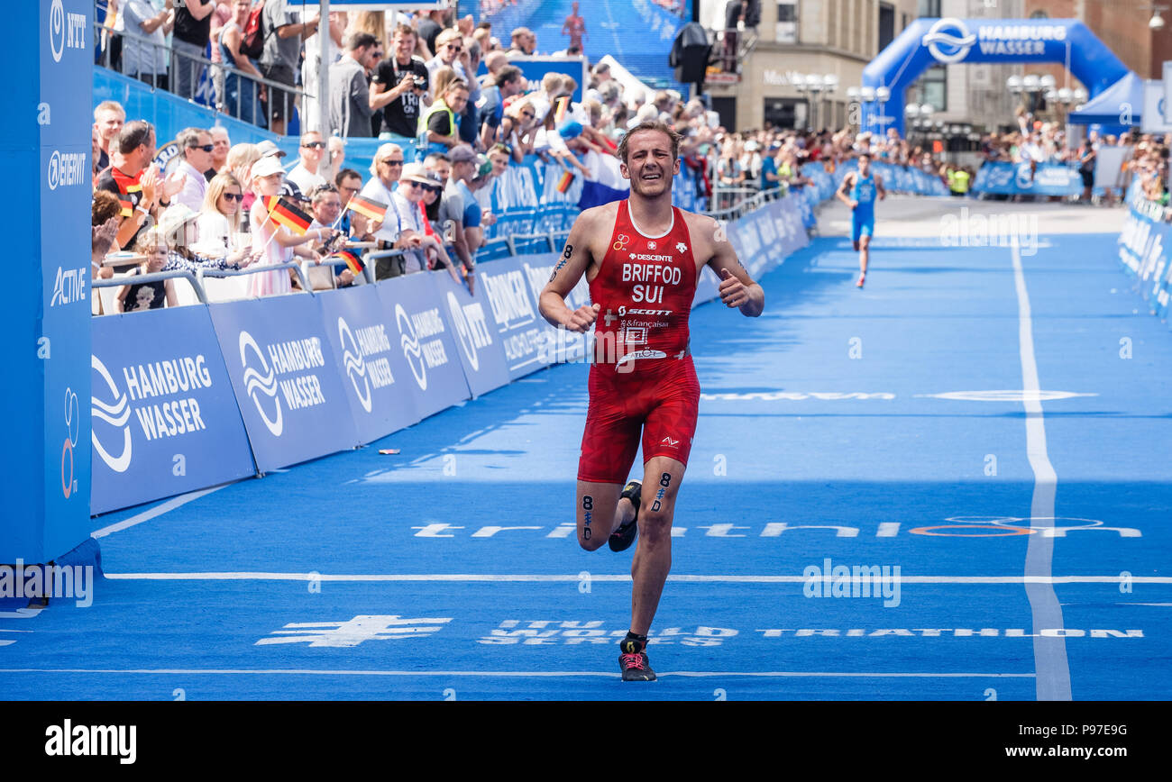 Hamburg, Germany. 15th July, 2018. Adrien Briffod from Switzerland crossing the finish line of the Triathlon Mixed Relay World Championship. Credit: Markus Scholz/dpa/Alamy Live News - Stock Image