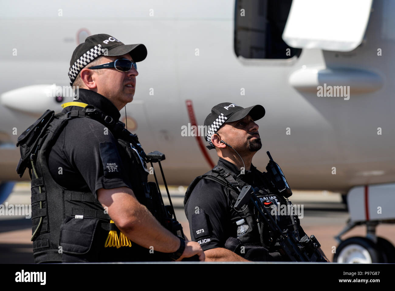 Royal International Air Tattoo, RIAT 2018, RAF Fairford. Armed police watch the flying display at the airshow - Stock Image