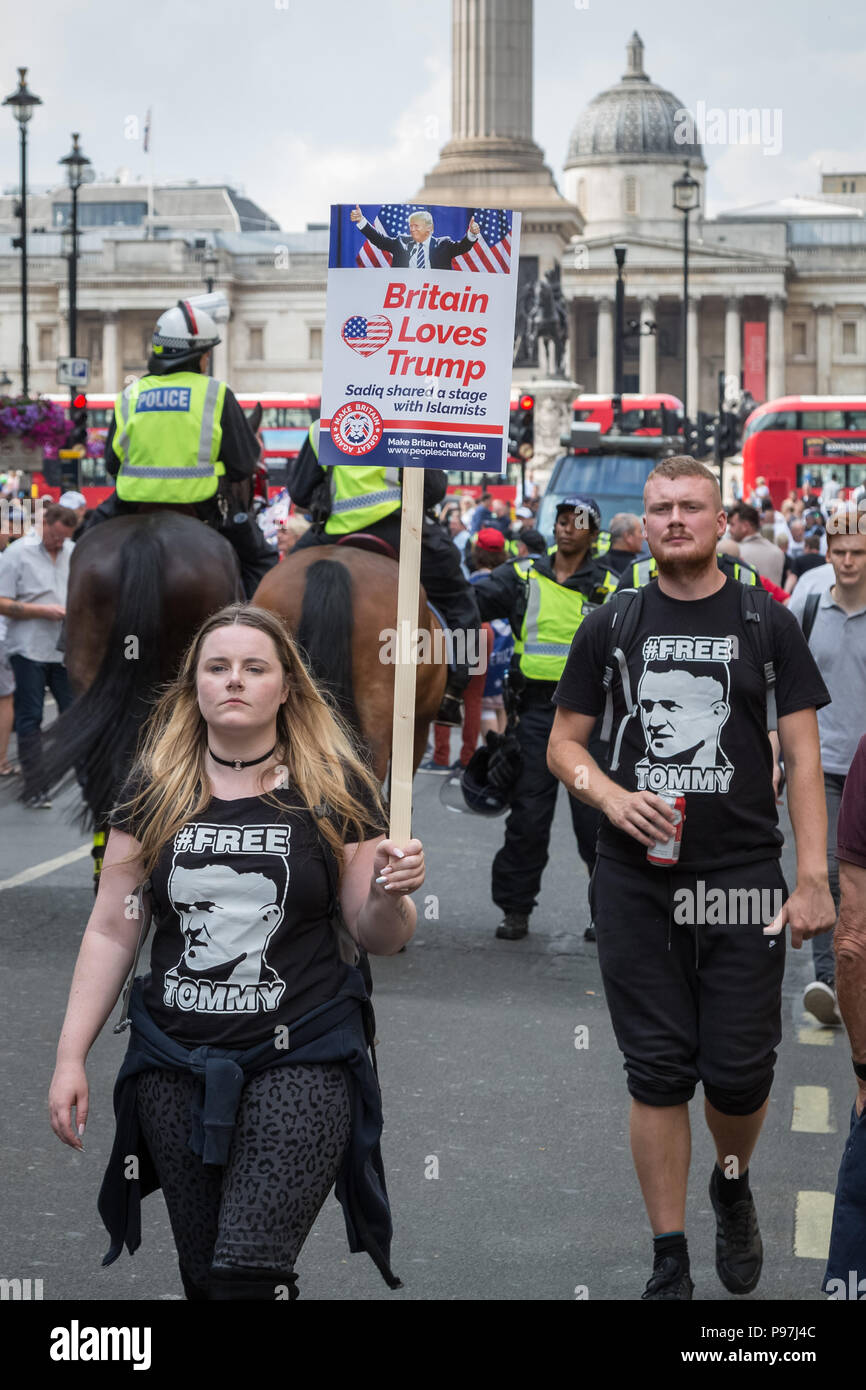 London, UK. 14th July 2018. Thousands of pro-Trump supporters join with 'Free Tommy Robinson' protesters to rally in Whitehall. Credit: Guy Corbishley/Alamy Live News - Stock Image