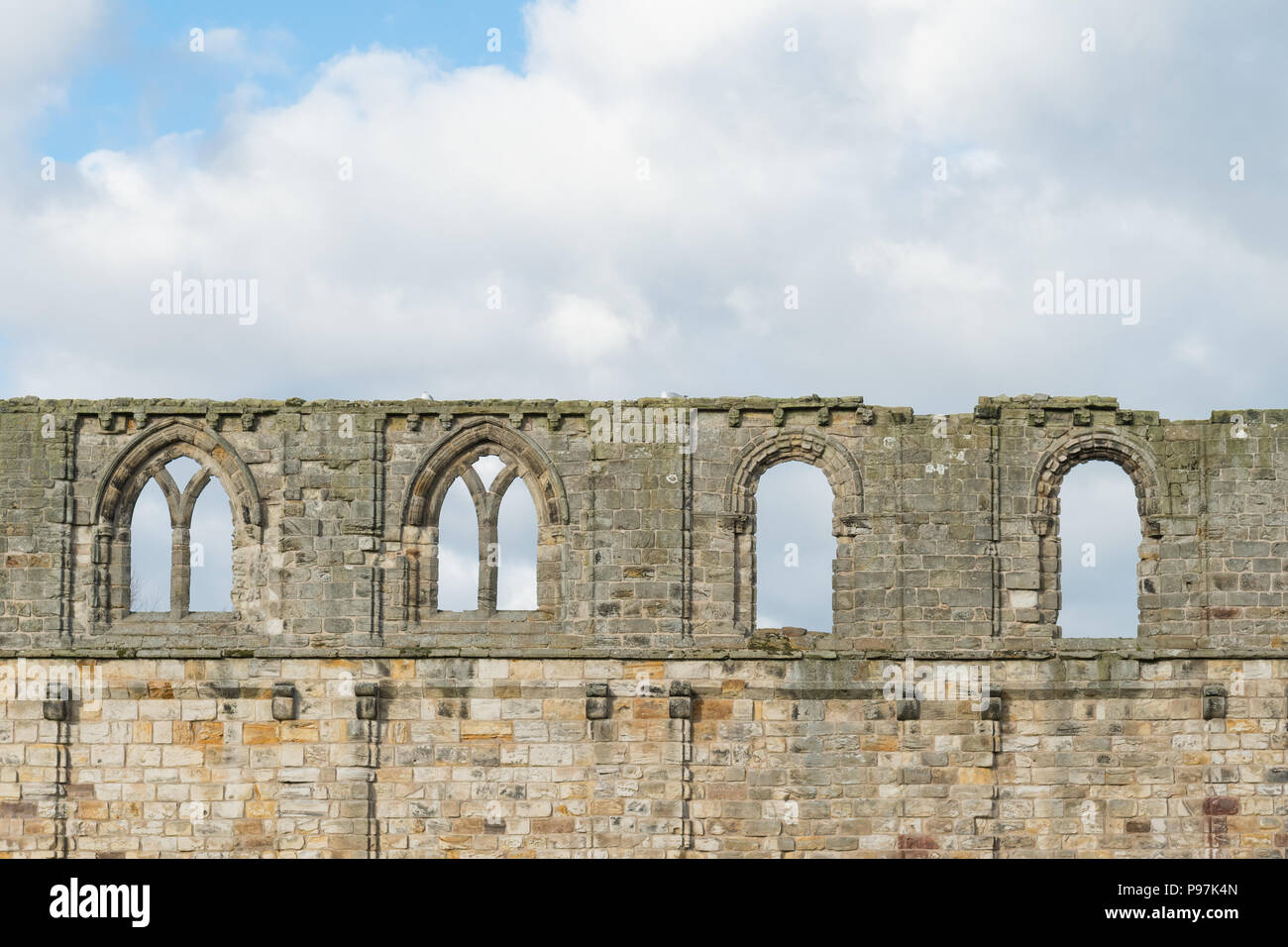 Change in building styles during cathedral construction - different window styles in south wall of St Andrews Cathedral, Scotland, UK - Stock Image