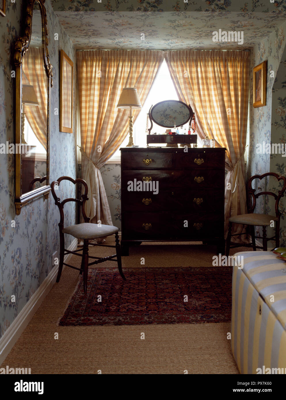Pair of antique chairs in a small bedroom with an antique ...