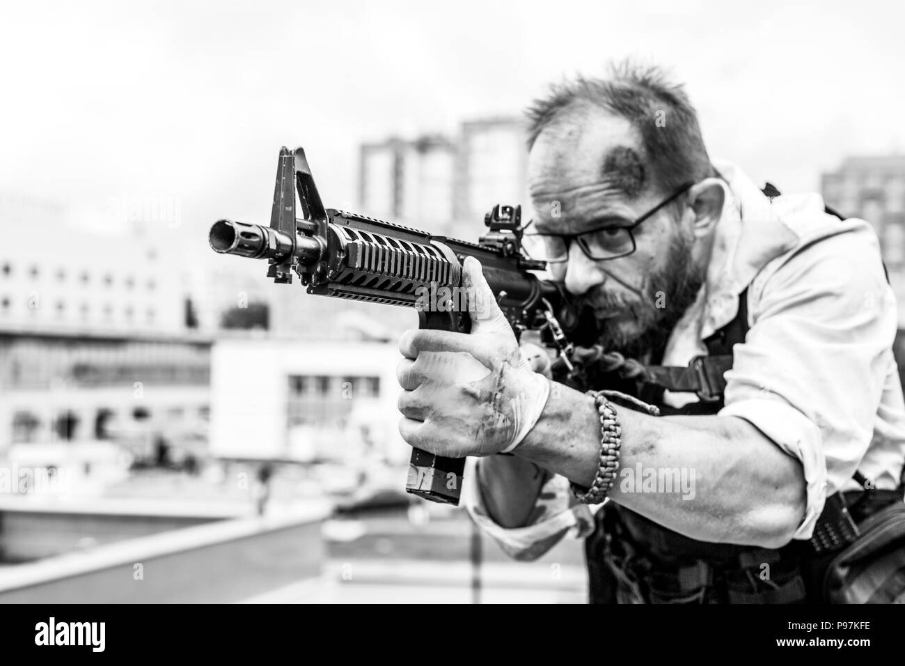 man took aim with the pistol. Action Movie Style - Stock Image