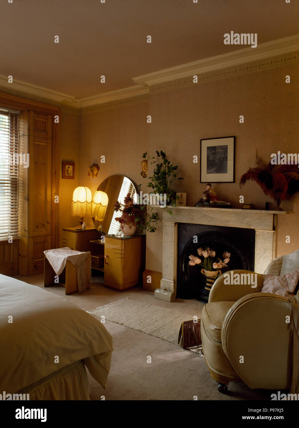 Lighted Lamp On Dressing Table Beside Fireplace In Thirties Style Bedroom