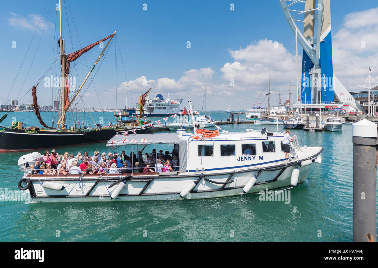 'Jenny M' boat from Solent & Wightline Cruises, on a harbour tour in Summer, full of Passengers at Gunwharf Quays, Portsmouth, Hampshire, England, UK. - Stock Image