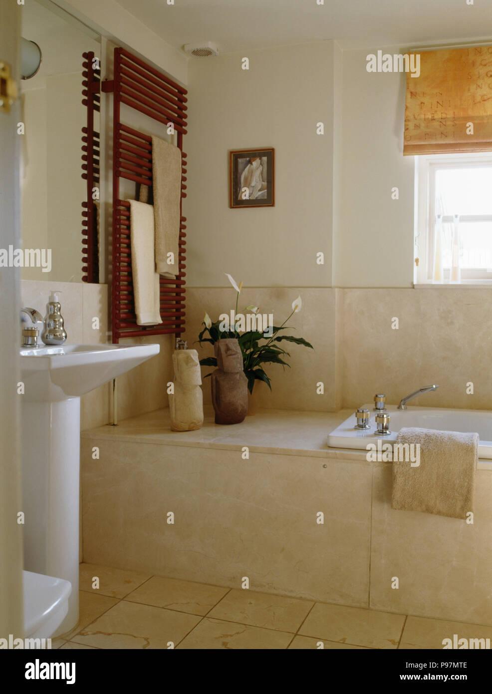 Marble Tiled Bath Panel In Neutral Bathroom