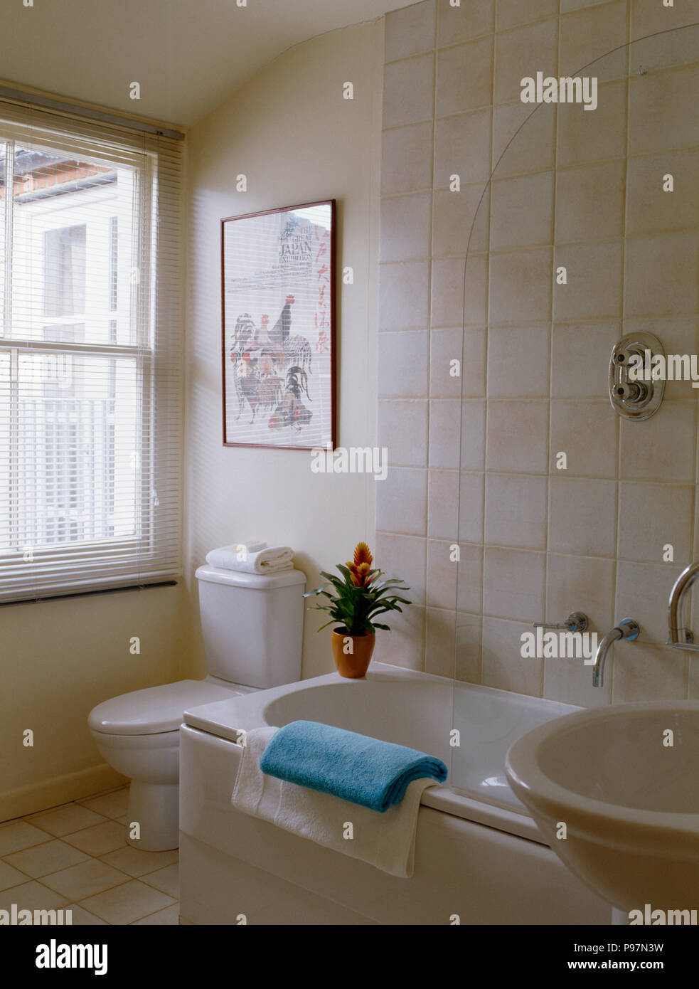 Small bathroom with glass shower screen on bath Stock Photo ...
