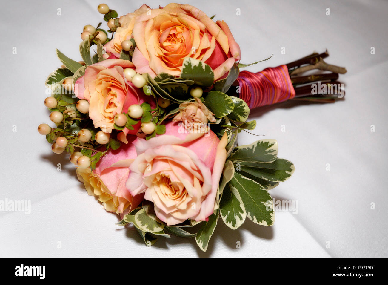 A Bouquet Of Wedding Flowers Pink And Orange Or Peach Colored Roses
