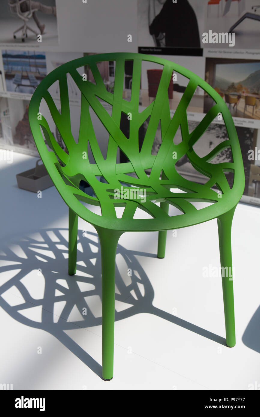 Detail look of a green vegetal chair design inspired by nature from Vitra on display. - Stock Image