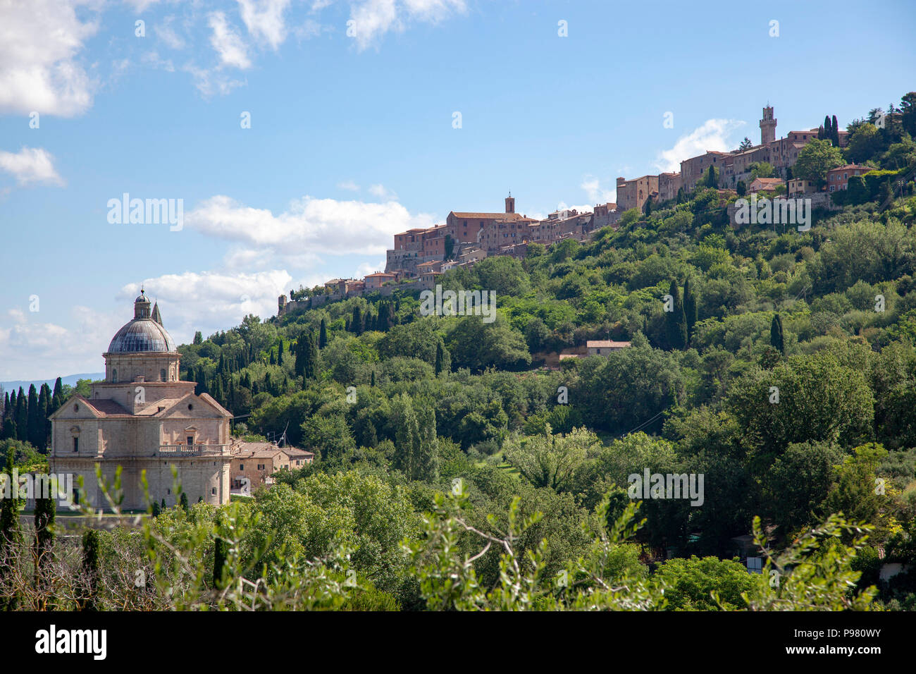 Below the town, the San Biagio church has been built according a focused Greek cross-shaped plan topped by a dome. Eglise de San Biagio en Toscane. - Stock Image