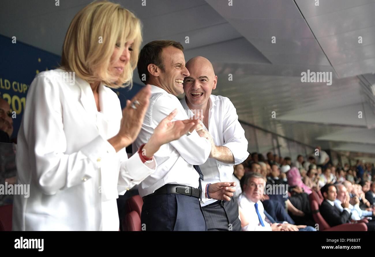 French President Emmanuel Macron Center And His Wife Brigitte Macron Celebrate With Fifa President Gianni Infantino