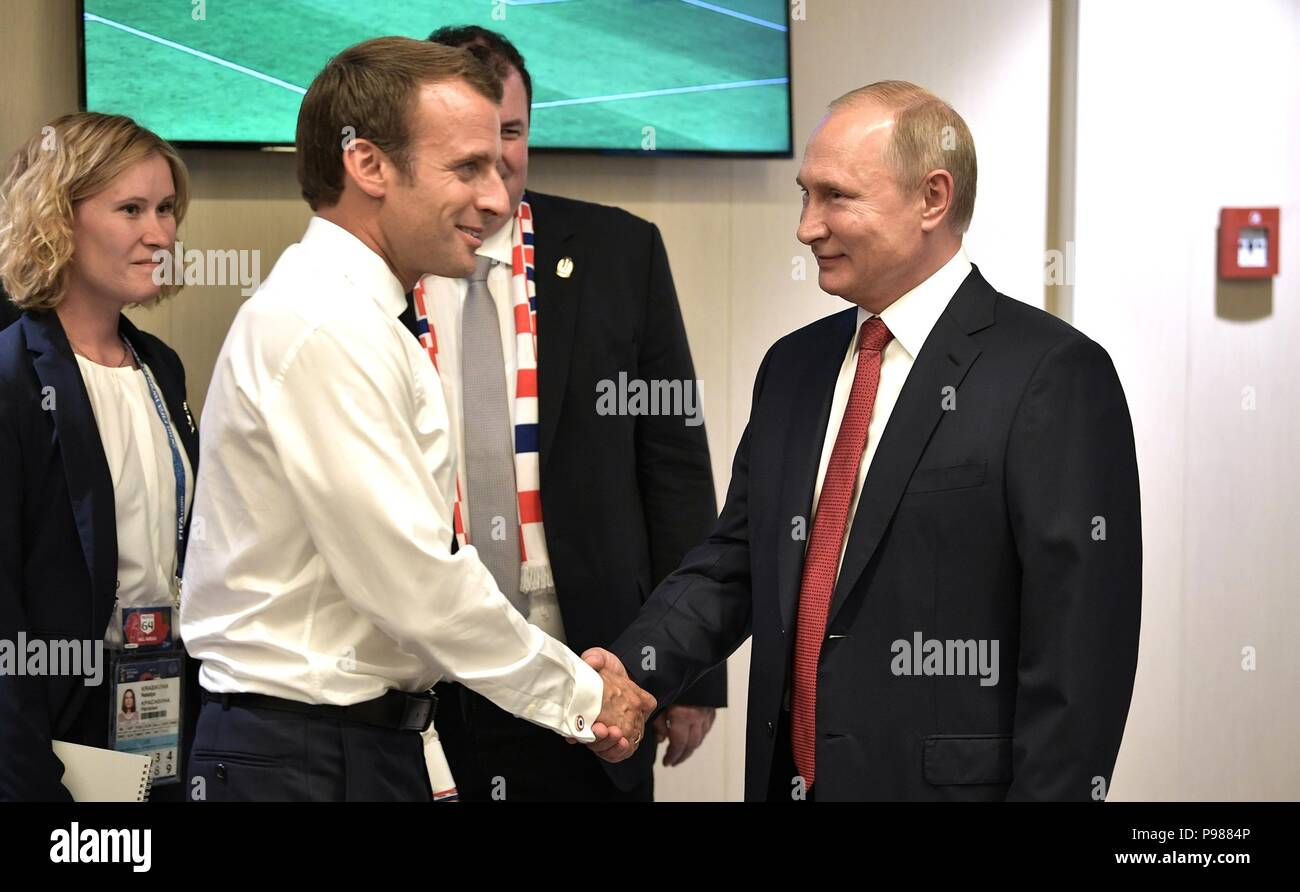 French President Emmanuel Macron, left, is congratulated by Russian President Vladimir Putin during the 2018 FIFA World Cup Final at Luzhniki stadium July 15, 2018 in Moscow, Russia. France defeated Croatia 4-2. - Stock Image