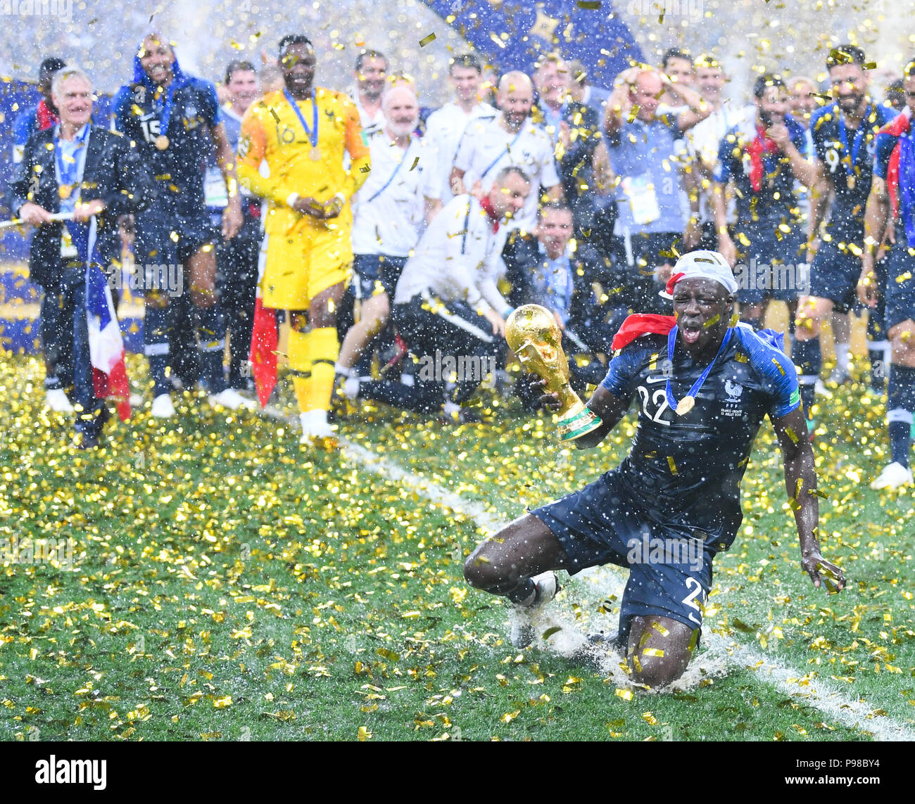 Moscow, Russland. 15th July, 2018. Winning Ceremony: Benjamin Mendy (France) cheers with the World Cup trophy after the handover. GES/Football/World Championship 2018 Russia, Final: France- Croatia, 15.07.2018 GES/Soccer/Football, World Cup 2018 Russia, Final: France vs. Croatia, Moscow, July 15, 2018 | usage worldwide Credit: dpa/Alamy Live News - Stock Image