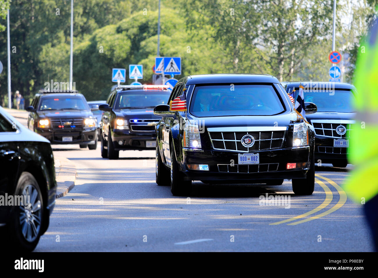 Helsinki, Finland. July 16, 2018. The motorcade of US President Donald Trump and First Lady Melania Trump passes along Ramsaynranta ahead of US and Russian Presidents' historic meeting. Credit: Taina Sohlman/Alamy Live News - Stock Image