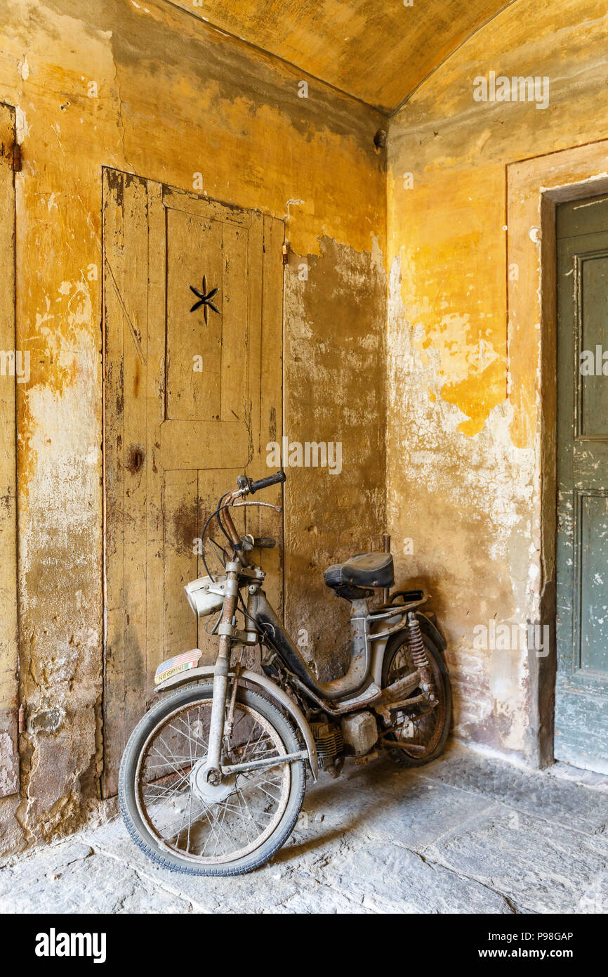 Moped in an old garage - Stock Image