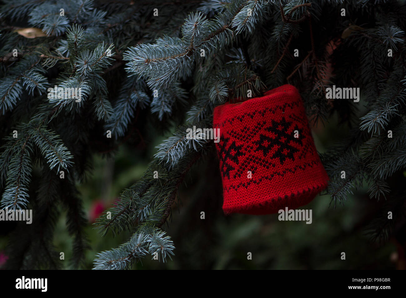 Knitted Christmas bell with folk ornaments in red color attached to ...