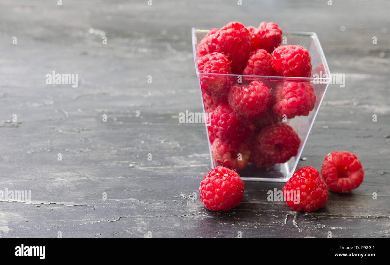 Fresh red raspberry on the wooden table - Stock Image