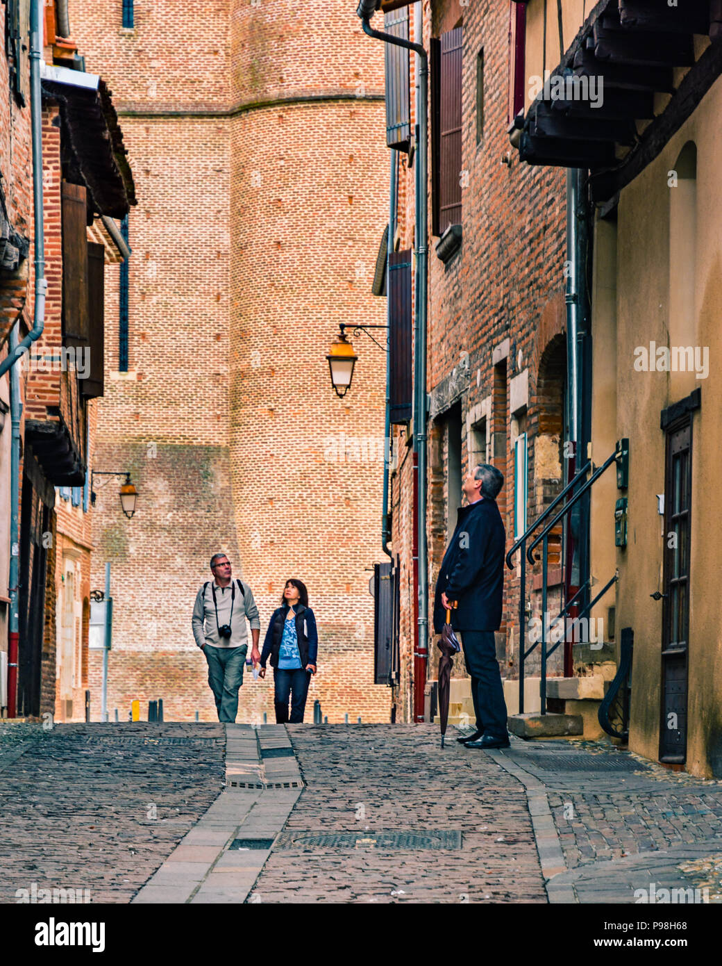 Tourists wander the medieval streets of the UNESCO listed Episcopal City of Albi, France Stock Photo