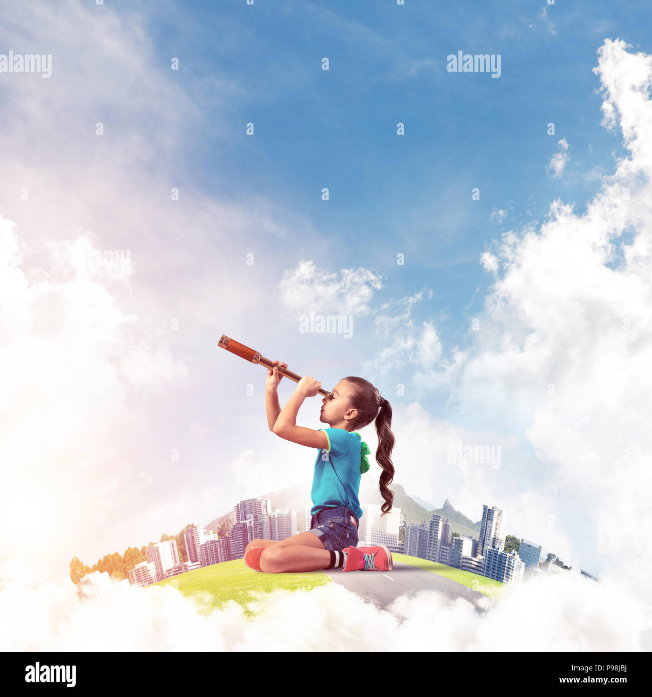 Concept of careless happy childhood with girl looking in future - Stock Image