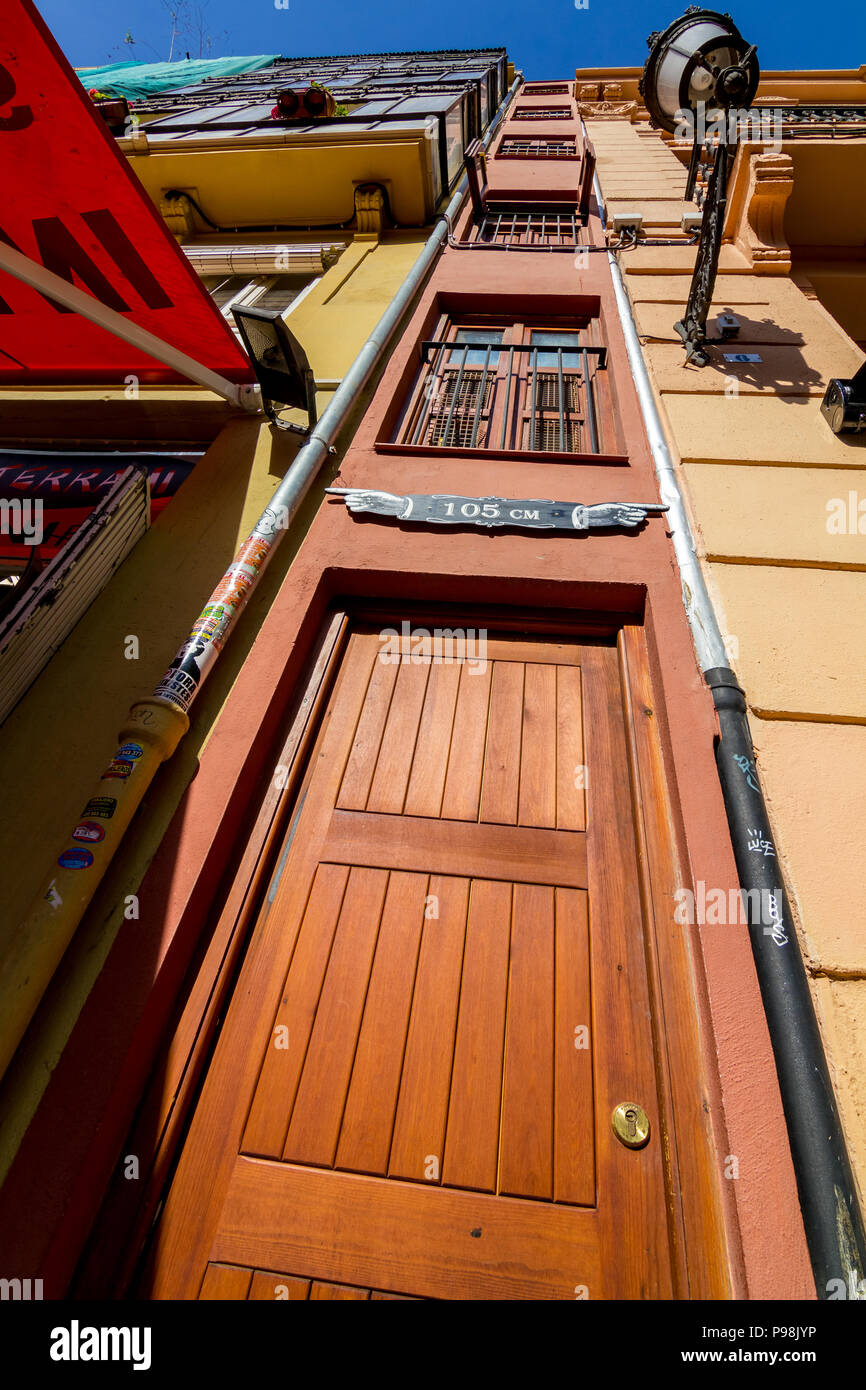 VALENCIA, SPAIN - FEBRUARY 18, 2013: The narrowest building in Europe is in Valencia and its width is 105 cm. Low angle photo taken in sunny spring da - Stock Image