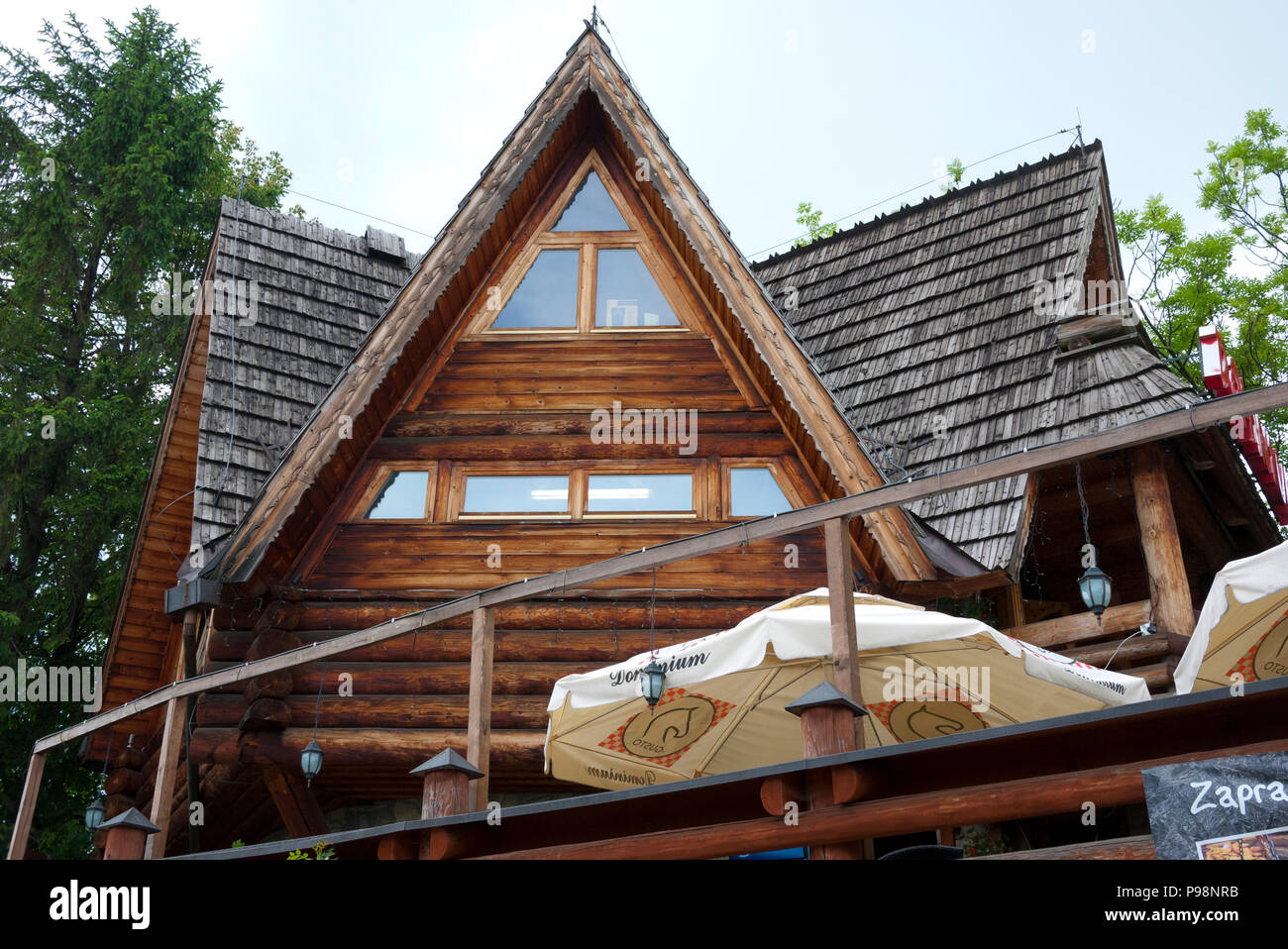 Typical acute sloping roof to combat heavy snowfall, Zakopane, Southern Poland, Europe. - Stock Image