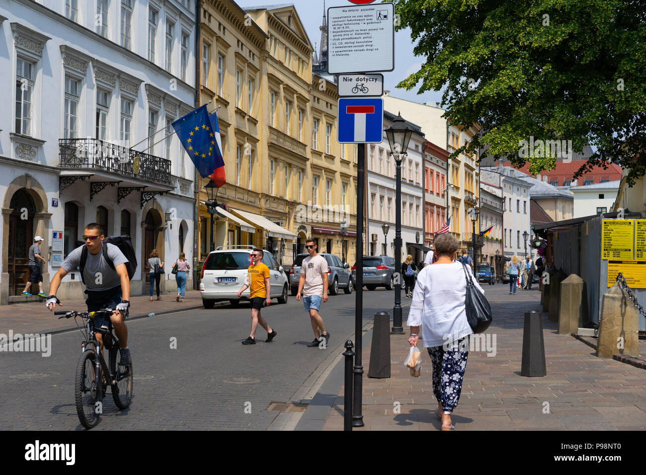 Cyclist on the streets of Krakow, Poland, Europe. - Stock Image