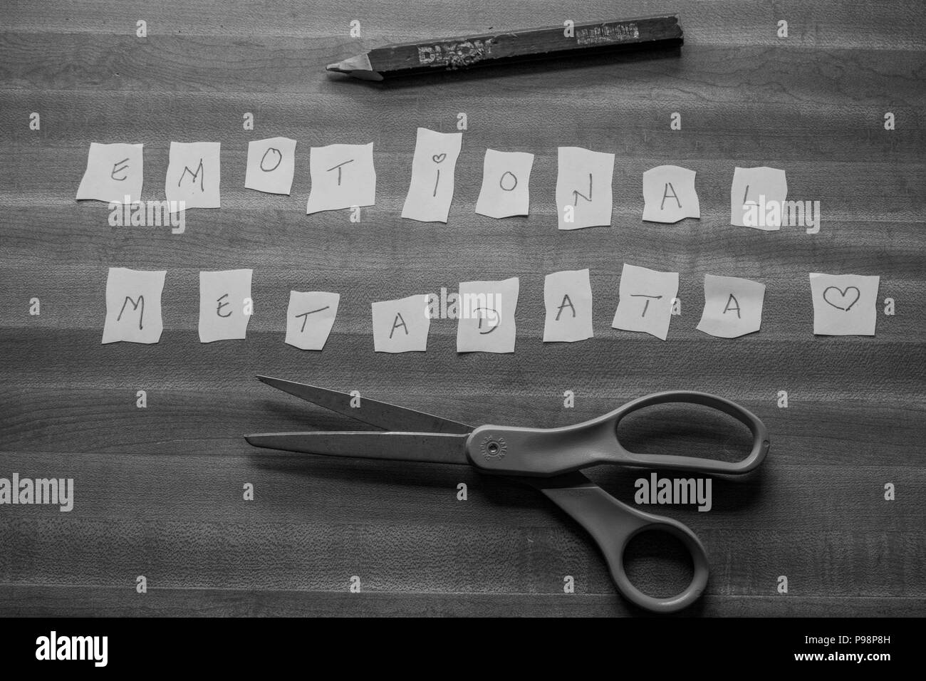 emotional metadata letters cut out of paper in black and white - Stock Image