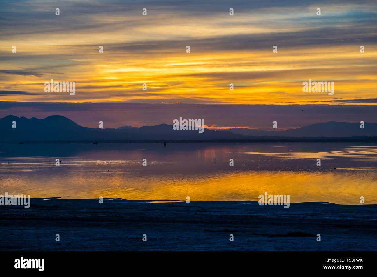 Dramatic vibrant sunset scenery in Lake Elsinore, California - Stock Image