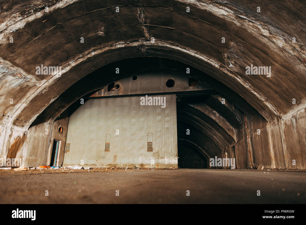 an abandoned aircraft hangar in the mountainside at Mostar Airport, Bosnia and Herzegovina Stock Photo