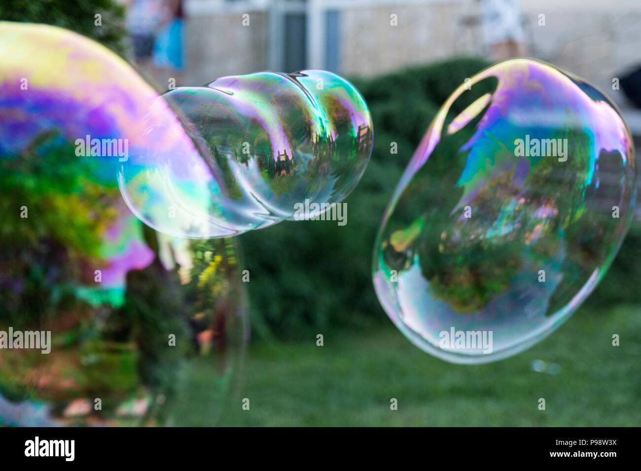 big soap bubbles in the garden - Stock Image