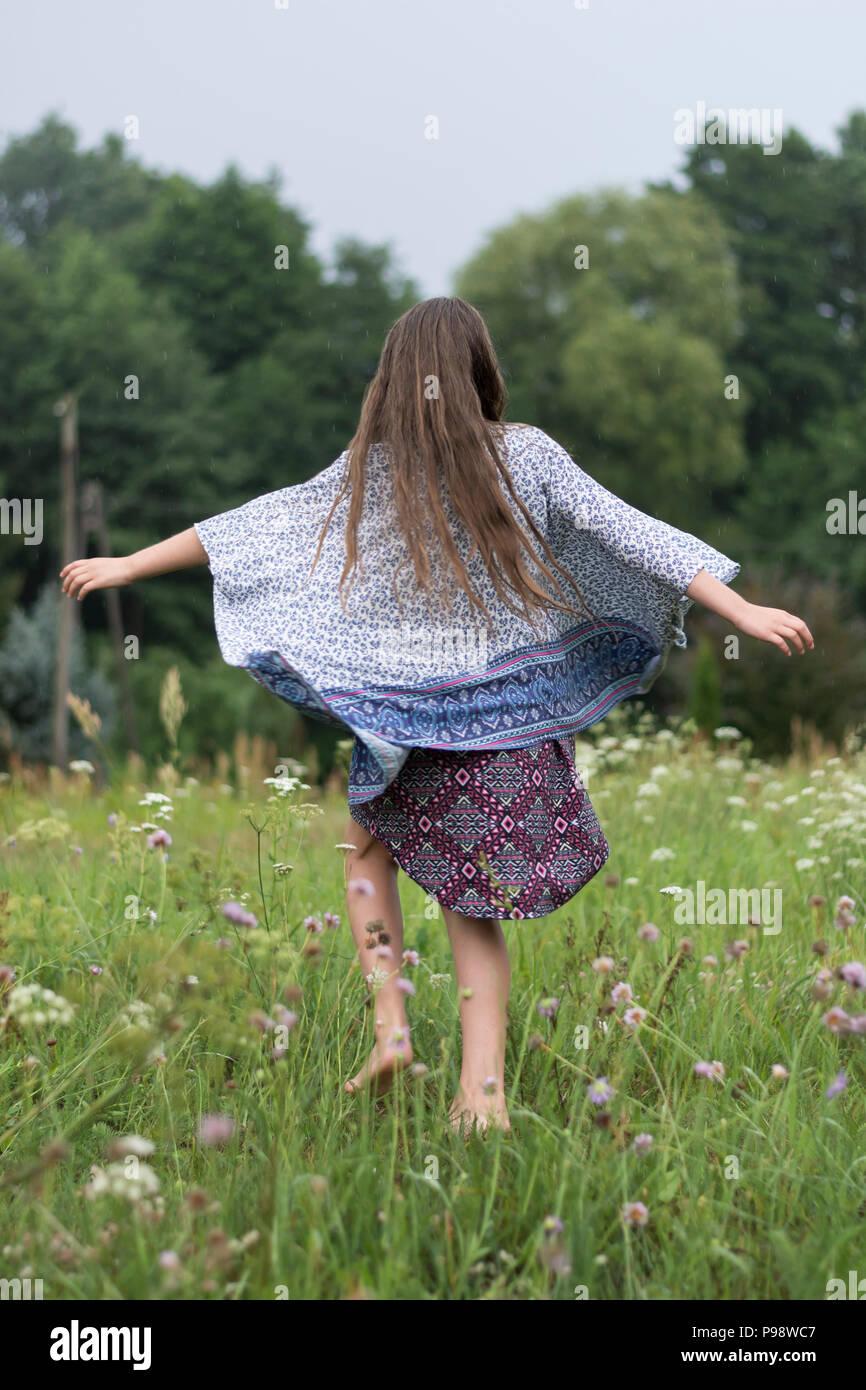 happy slavic girl dancing in the rain - Stock Image