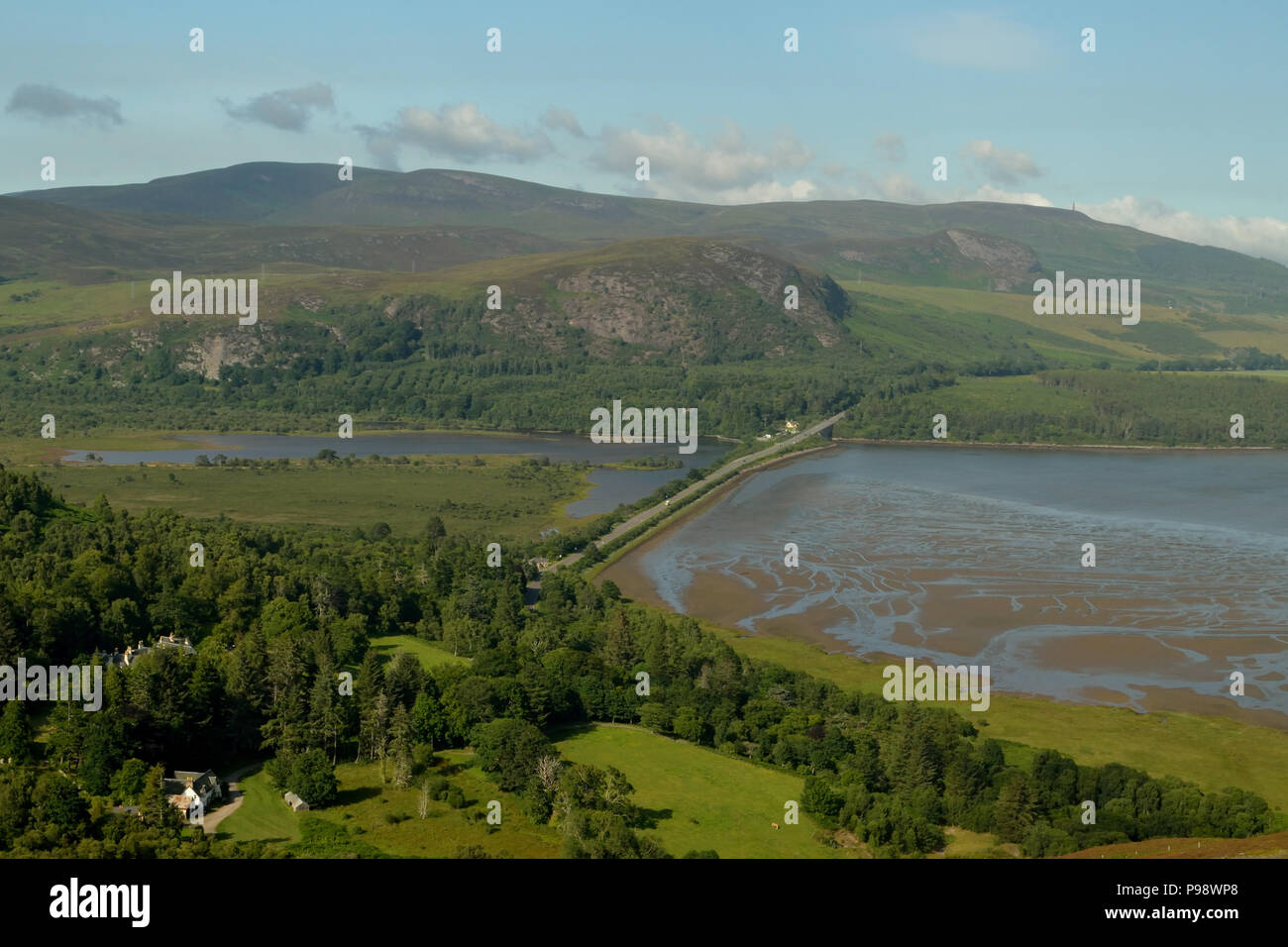 View of the A9 Trunk Road where it crosses the valley of Strath Fleet at the Mound, in the Scottish Highlands - Stock Image