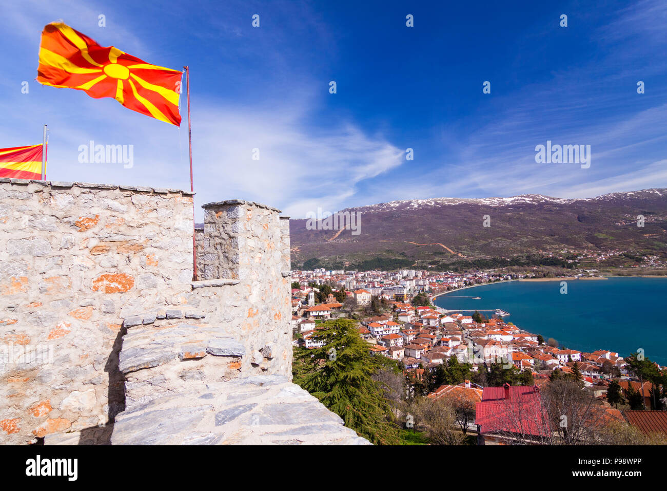 Ohrid, Republic of Macedonia : Macedonian flags on top of Samuel's Fortress and overview of the Unesco listed Ohrid old town and Ohrid lake. Built on  Stock Photo