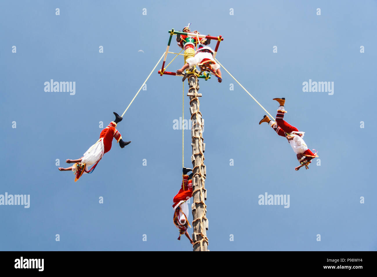 Teotihuacan, Mexico : Totonac people dressed in traditional clothes performing the Voladores or Flying Men ceremony named an Intangible cultural herit - Stock Image