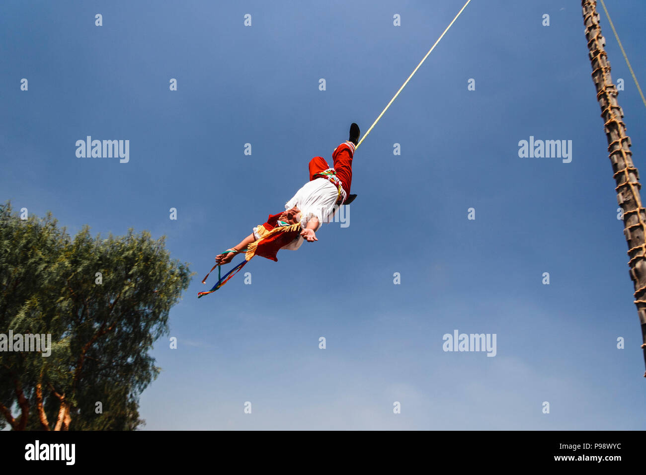 Teotihuacan, Mexico : Totonac man in traditional clothes performing the Voladores or Flying Men ceremony named an Intangible cultural heritage by UNES - Stock Image