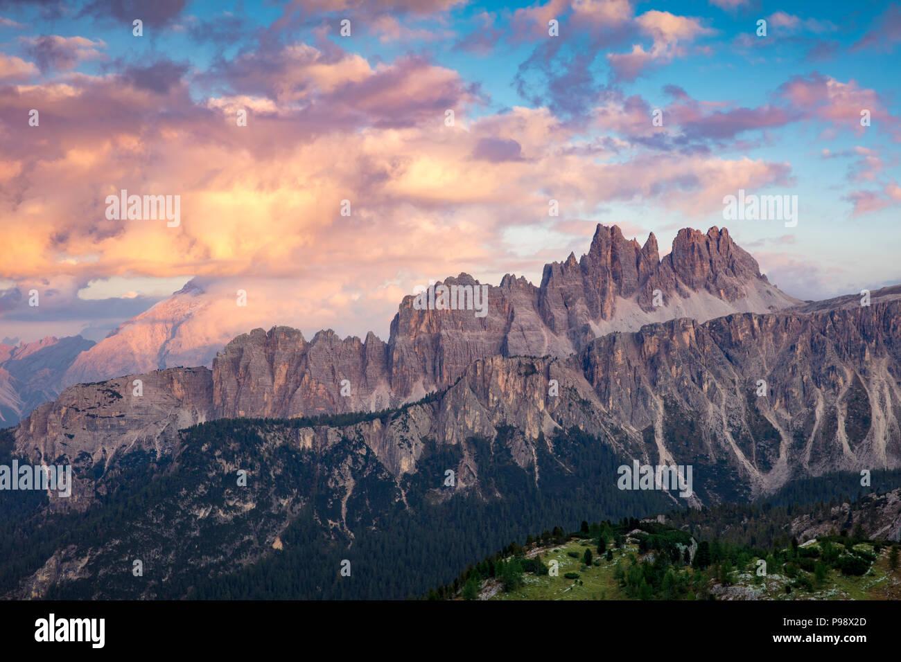 Colorful evening clouds over Croda da Lago & Lastoni di Formin mountain ranges, Dolomite Mountains, Belluno, Italy - Stock Image