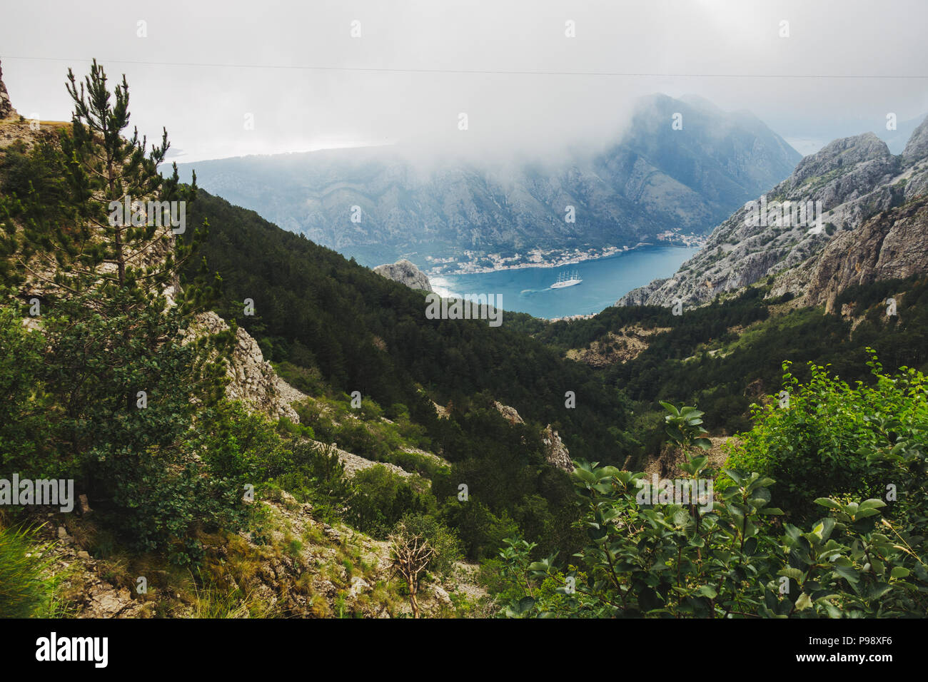 Cloud looms over the Bay of Kotor on an otherwise-sunny summer's afternoon in Kotor, Montenegro Stock Photo
