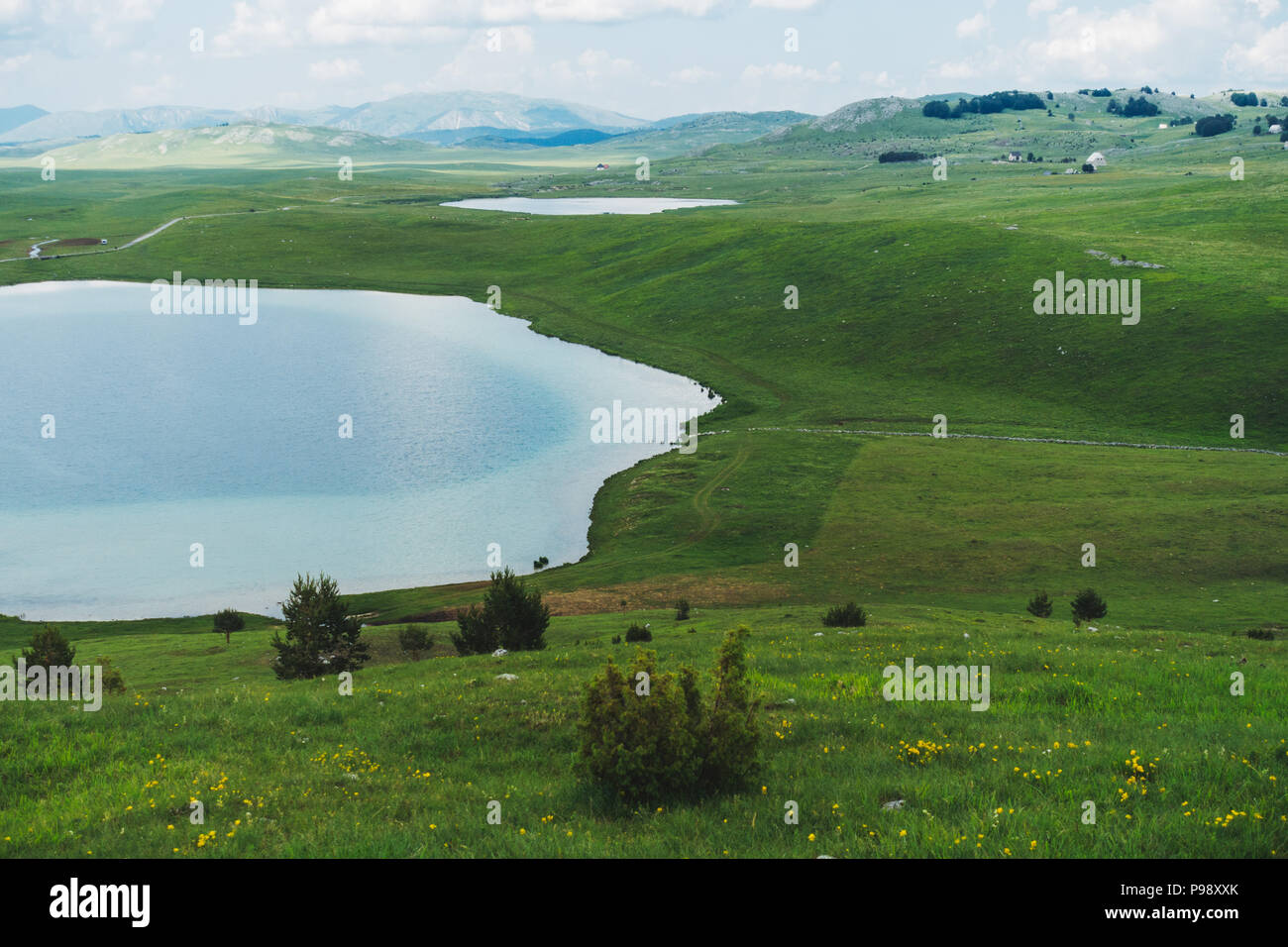 Vrazje Jezero (Devil's Lake), a two-tone glacial lake in the middle of rolling green hills near Zabljak, Montenegro - Stock Image