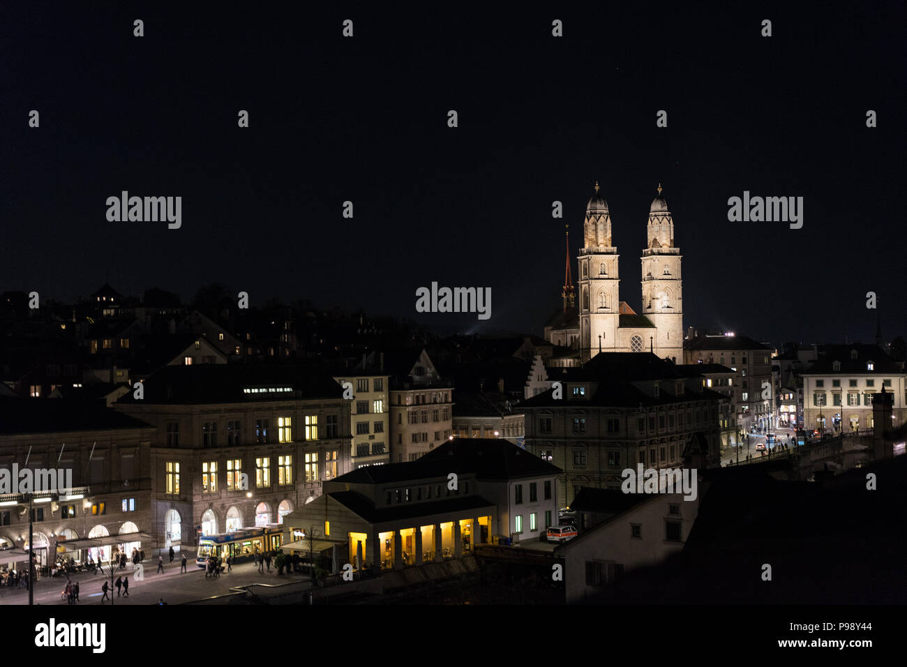 Zurich city by night with famous Grossmuenster building, Switzerland - Stock Image
