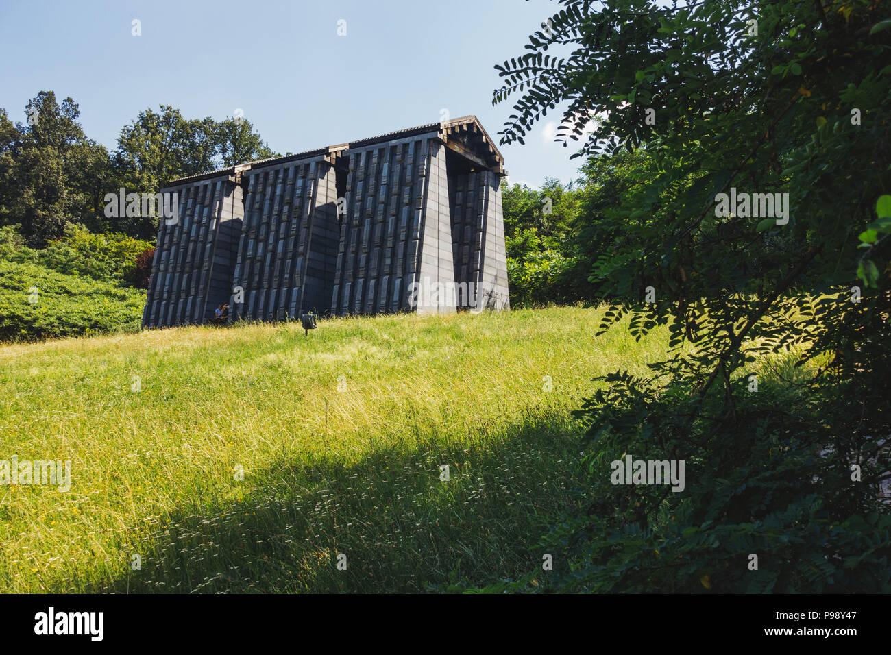 the dark concrete slabs of the Yugoslav-era Mausoleum of Struggle and Victory, Čačak, Serbia Stock Photo