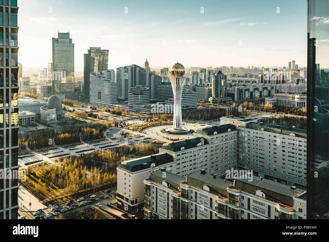 Sunset view towards Bayterek tower and hous of ministries in Astana Kazakhstan on a clear day Stock Photo