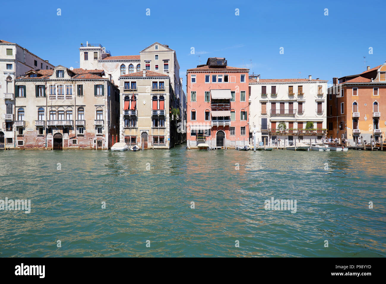 Venice houses facades and the grand canal in a sunny day in Italy - Stock Image